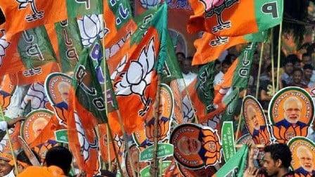 BJP distributing poster